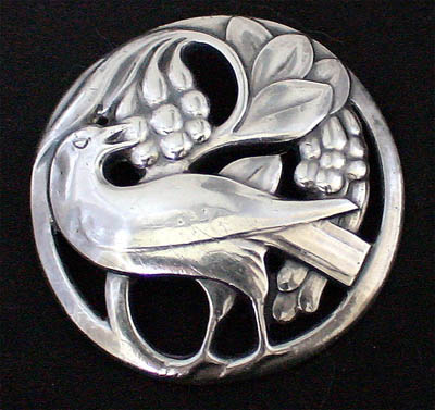 Early Jensn bird eating berried brooch circa 1908